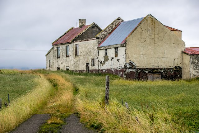 An abandoned farmhouse on the side of the road outside of Reykjavik, Iceland