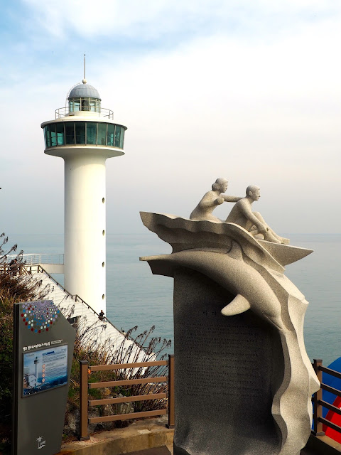 Yeongdo Lighthouse and statue in Taejongdae Park, Busan, South Korea