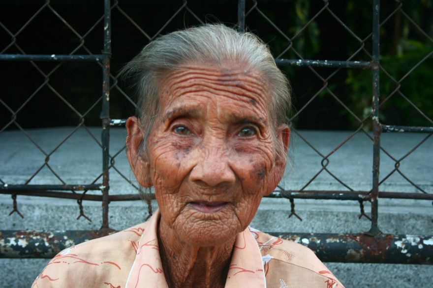 An old lady inside Manila North Cemetery