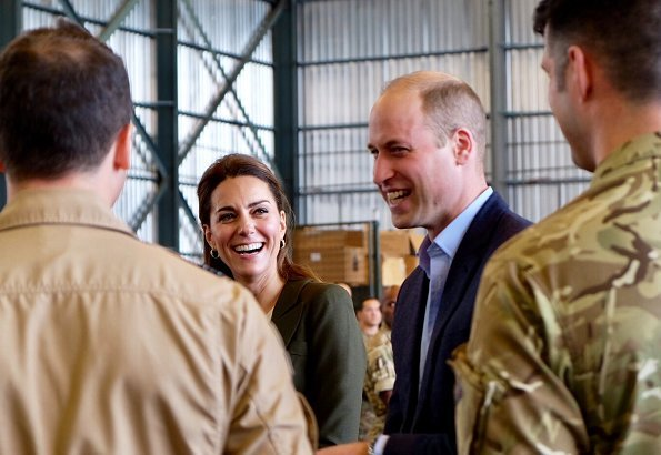 Kate Middleton's wearing her Smythe Duchess Blazer in Army green, and she carried L.K. Bennett Dora Khaki suede clutch