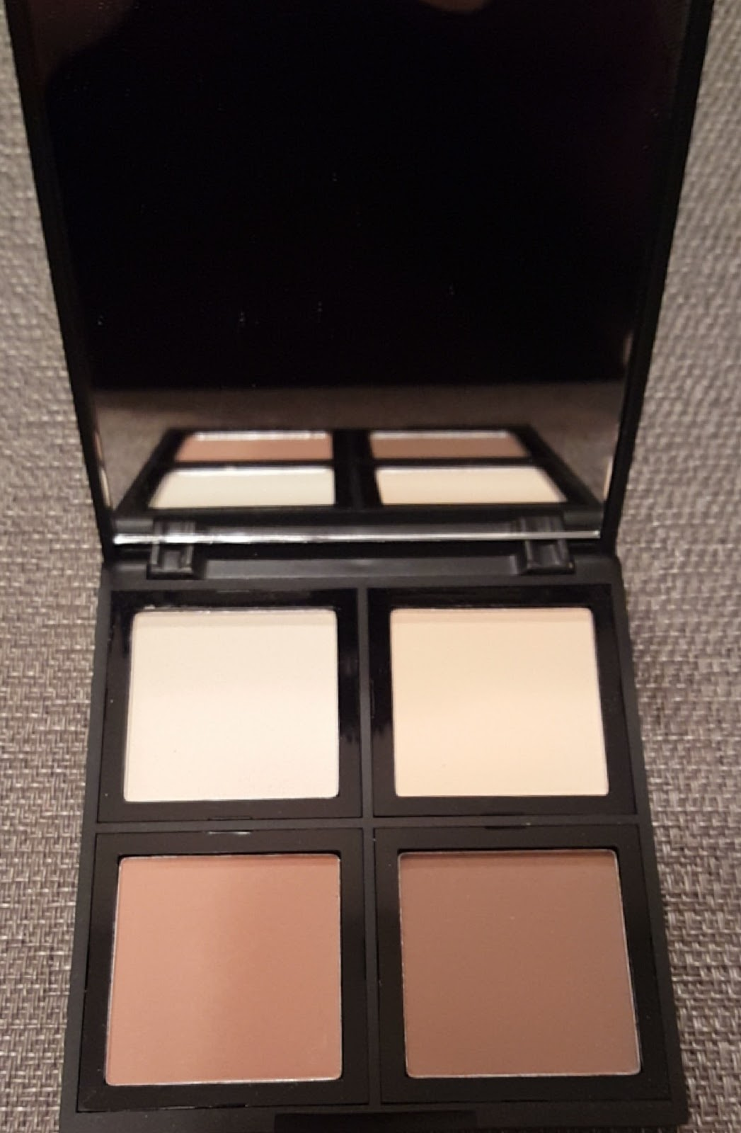 The Contour Palette A Sleek Square Design With A Big Mirror Inside Its The  Same Size As The Blush Palettes That They Sell The 4 Powders Inside Are  Also A