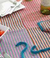 http://www.letsknit.co.uk/free-knitting-patterns/stripy_picnic_blanket