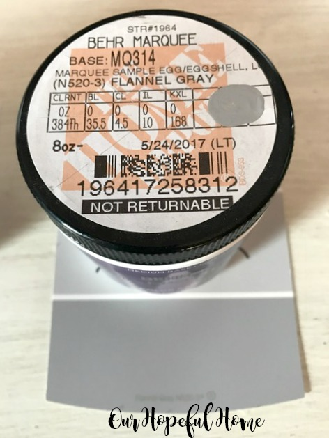 gray sample paint jar with matching paint chip card