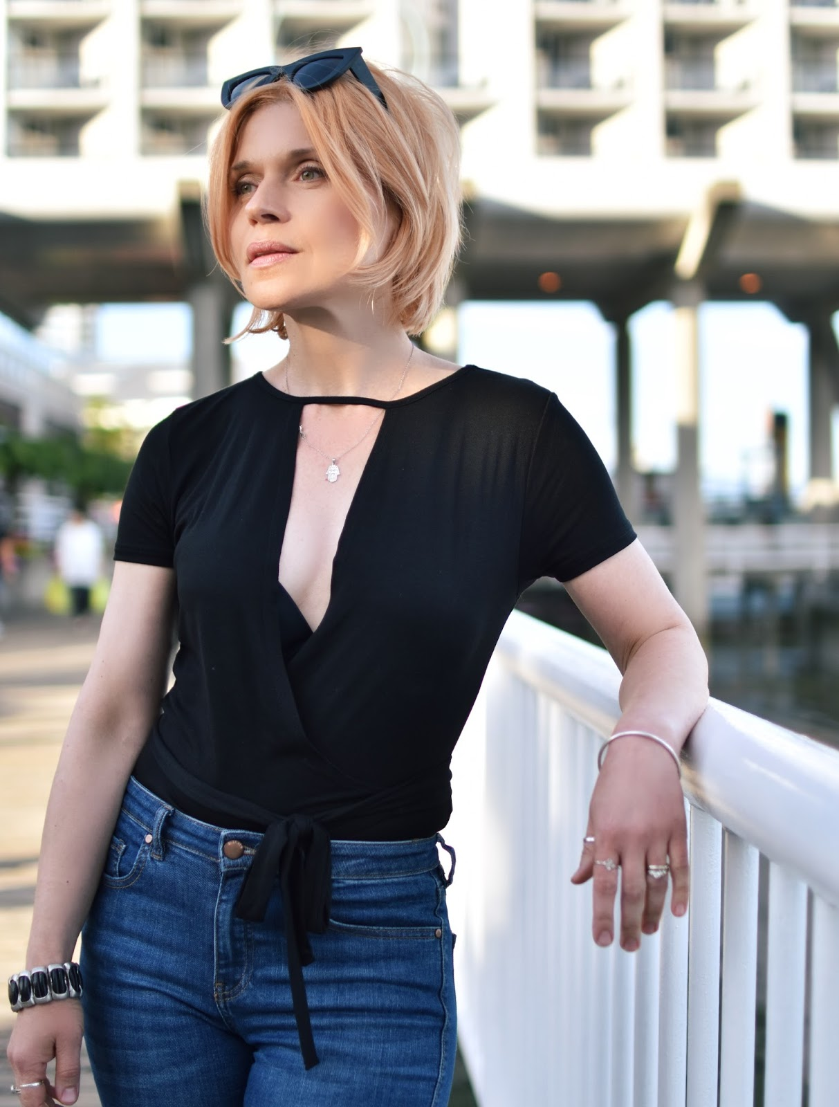 short-sleeved wrap top, cat-eye sunglasses