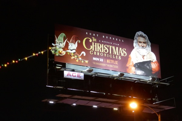 Christmas Chronicles string lights billboard night