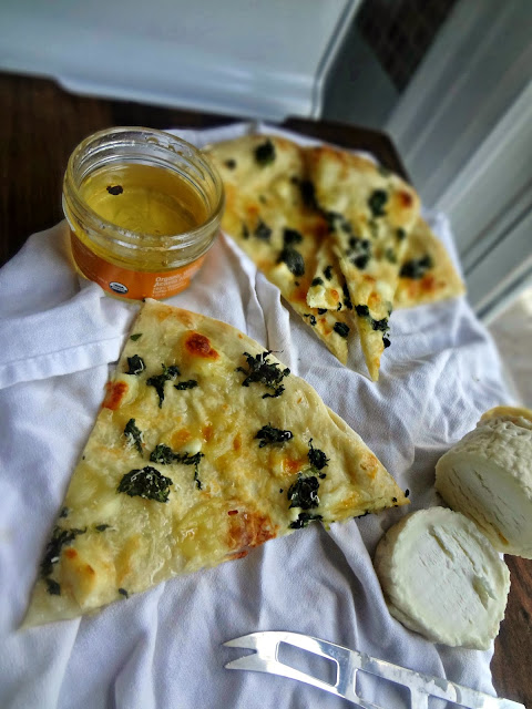 Chevre and Spinach Pizza with Truffle Honey