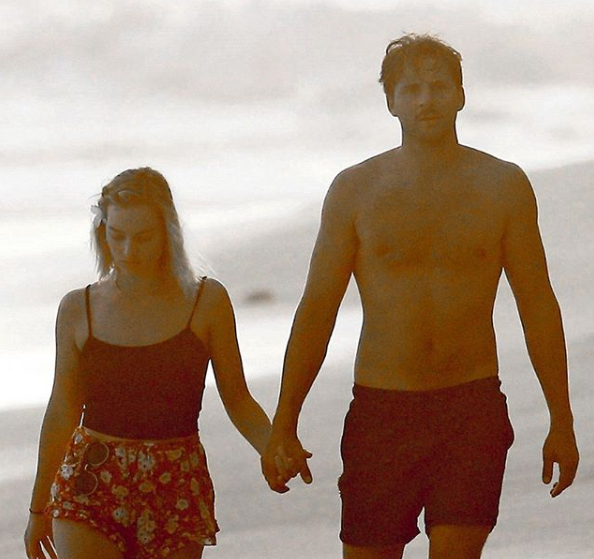Margot Robbie and hot hubby Tom Ackerley on a long walk on the beach.