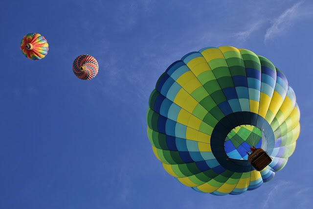 Hot air balloons flying