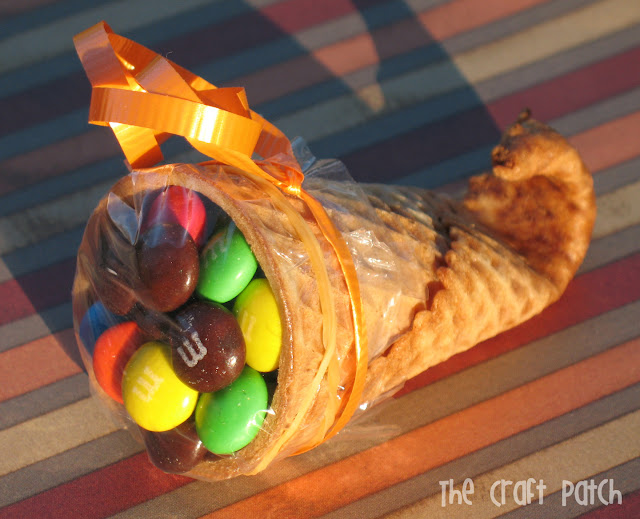 Make a miniature cornucopi from a sugar cone and fill it with candy for a festive Thanksgiving treat.