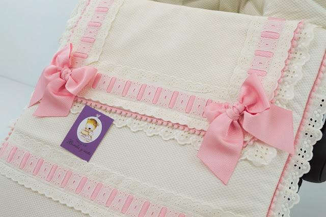 carseat  footmuff cream pink