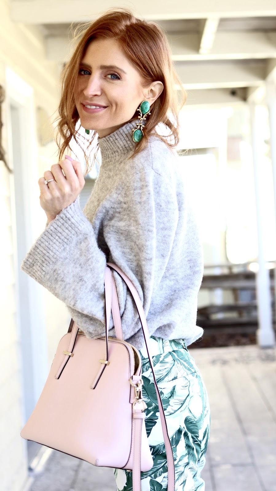 Winter to Spring Dressing, Spring pastels, grey turtleneck flared sleeves, palm print pants Old navy, Kate Spade bag, Expressions white block heel mules