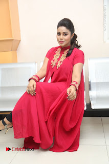 Actress Poorna Latest Stills in Red Dress at Rakshasi First Look Launch  0292.JPG