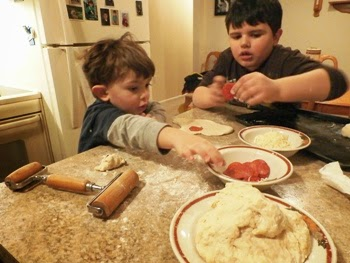 Bobby and Tyler making pepperoni rolls