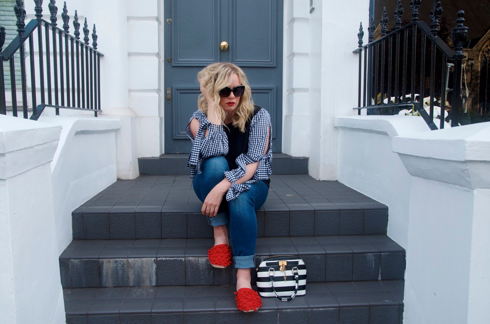 Red pom-pom shoes, gingham top, black sunglasses and denim
