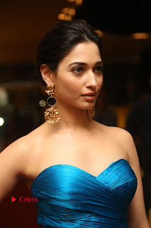Actress Tamannaah Pictures in Blue Long Dress at Abhinetri Audio Launch  0022