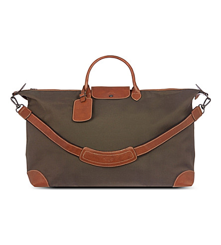 Green and brown leather weekend luggage
