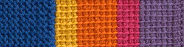 A sample of the colours and stitches of these placemats. Left-right: royal blue purl stitches, then afghan stitches in golden yellow, orange, hot pink and lavender.