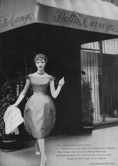 Model in front of department store wearing a Hattie Carnegie Designed ensemble