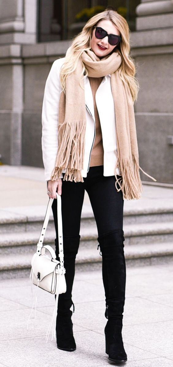 how to style a beige scarf : white biker jacket + boots + bag + nude sweater + black skinnies