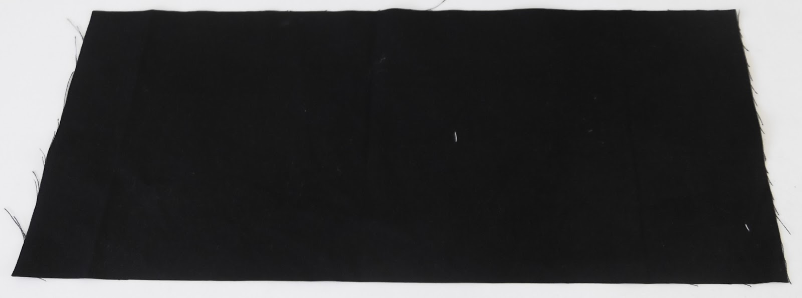 black fabric, a piece of black fabric