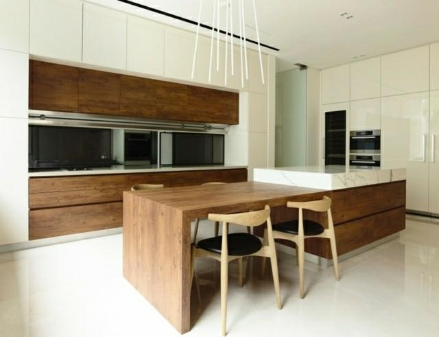 Arte y arquitectura: cocinas con isla y mesa adosada