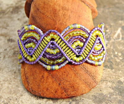 Beaded macrame bracelet in purple and green.