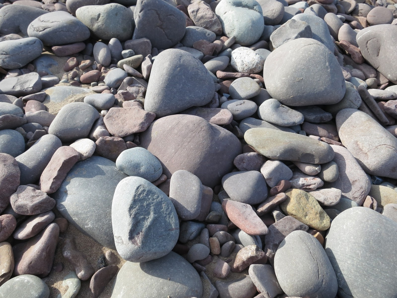 Blue, grey and pink pebbles on beach at Minehead, Somerset