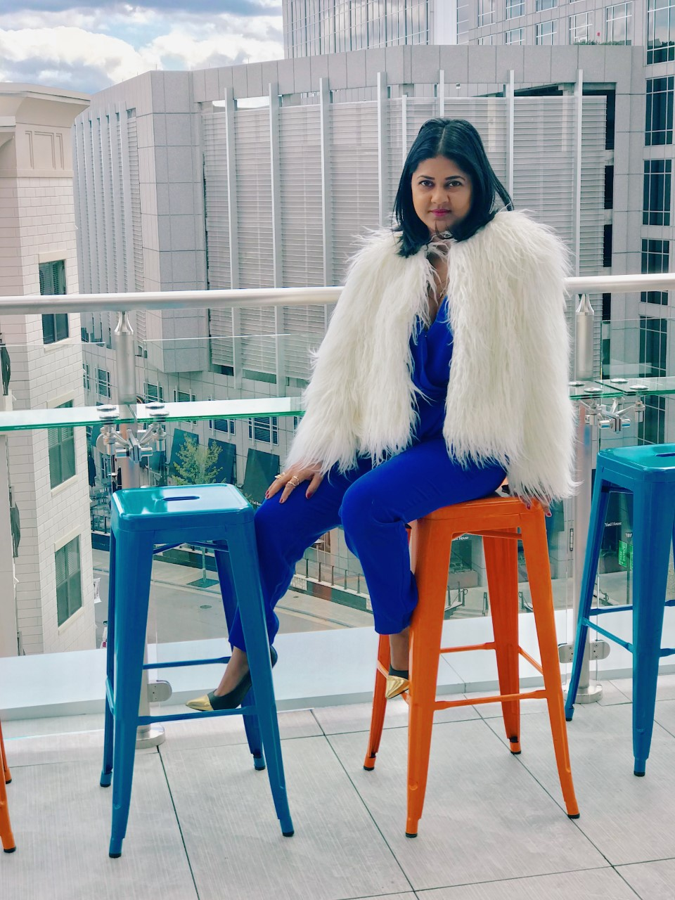 blue DVF jumpsuit white fur from lou & grey
