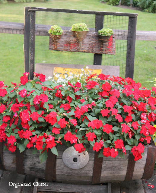 Horizontal Wooden Barrel with Red Impatiens