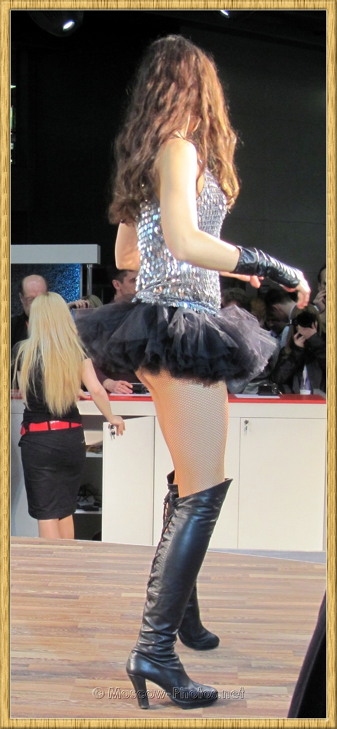 Long Haired Russian Model Dancing on Knee High Boots