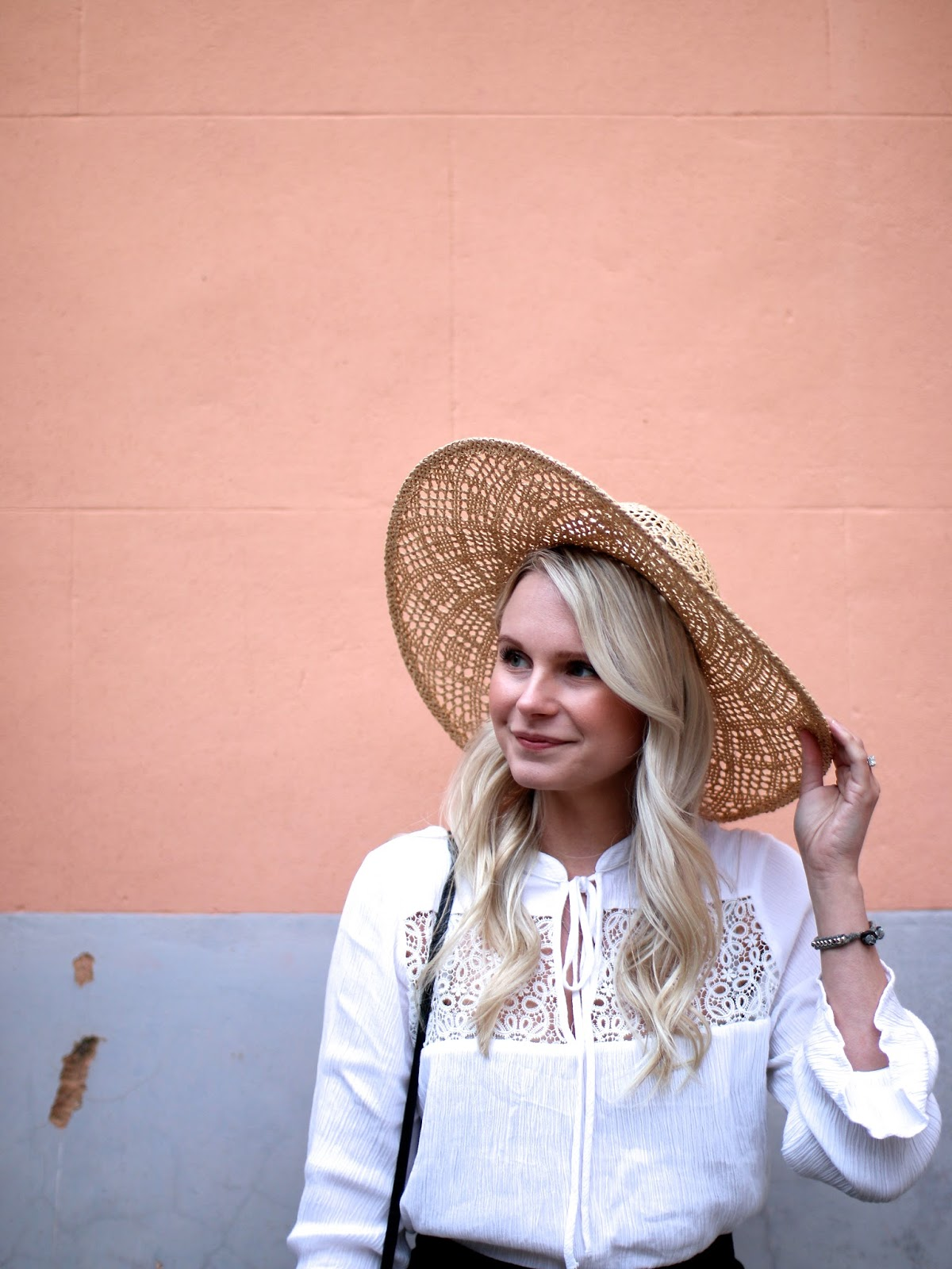 lace blouse and floppy hat