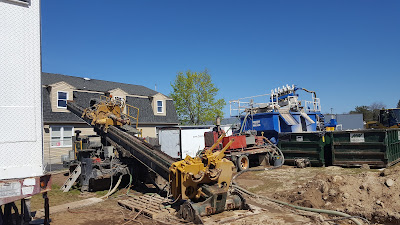 horizontal drilling equipment replacing a sewer main along East Central St