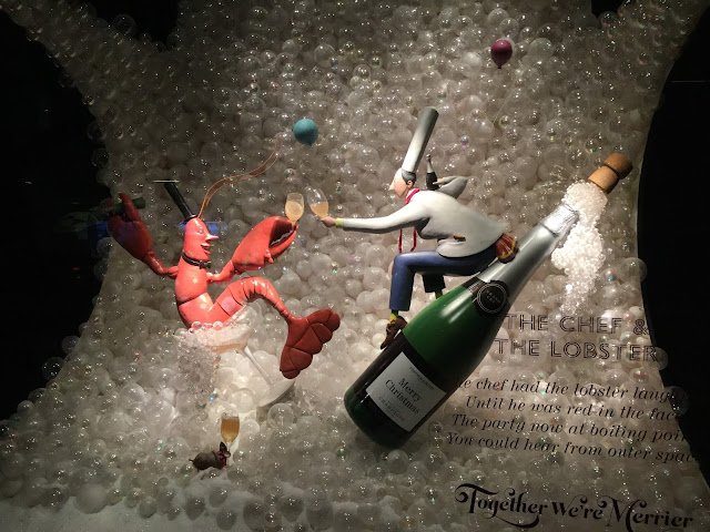 Pic of Lobster, Chef and bottle with backdrop of bubbles