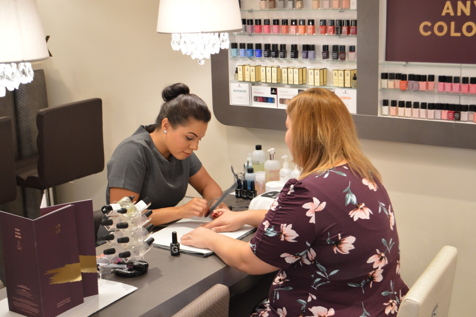 this is a picture of a nail technician applying gel polish
