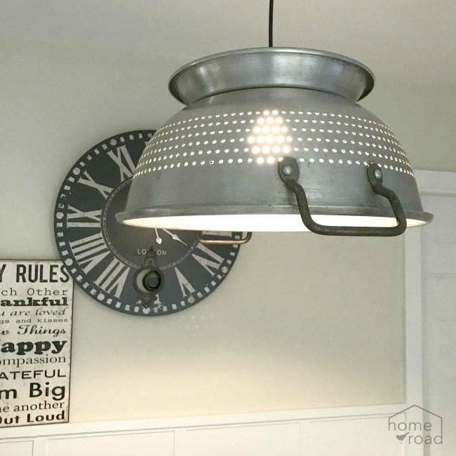 A beautiful hanging farmhouse style colander light