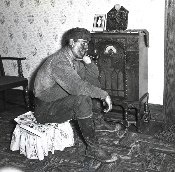 A hardworking miner listens to the radio. c.1930s Appalachian East Tennessee. Jingles and other stories about The American Dream. marchmatron.com