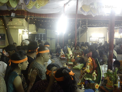 People performing aarti and pooja before the Ganpati visarjan