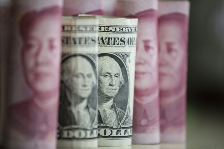 The yuan is trading at its lowest level in eight years against the dollar after dropping about seven percent in a year, as Beijing sells greenbacks to support it