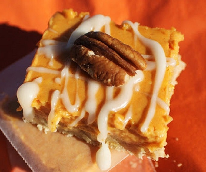 this is how to make pumpkin pie square cheesecake recipes with pecan and a frosting drizzle on top