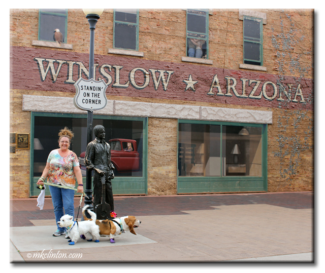 Woman and two dogs on corner in Winslow, Arizona