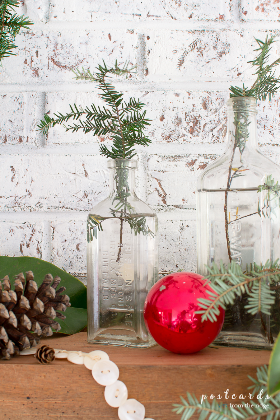 vintage glass bottle with hemlock branch