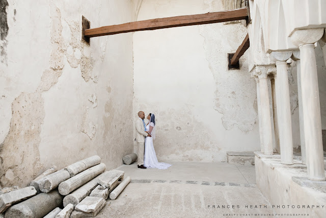 Bride and groom in Hotel Convento cloisters