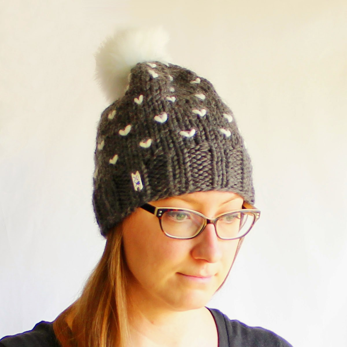 Each Toque is hand knitted with a soft Acrylic Wool blend yarn with 100%  wool roving Fair Isle Hearts. The Grey Hat has a white faux fur pompom and  the ... ef347996add