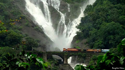 Train crossing British era bridge at Dudhsagar Water Falls