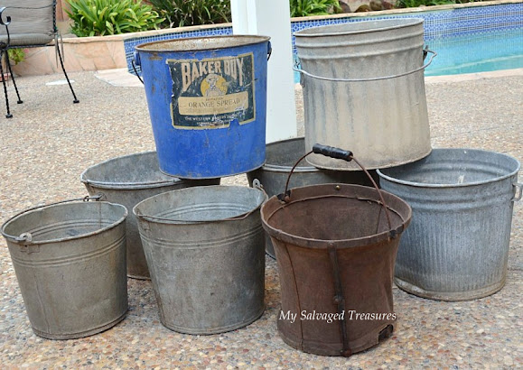 old galvanized buckets with new labels