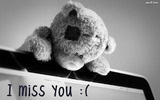 sad teddy bear with i miss you quote