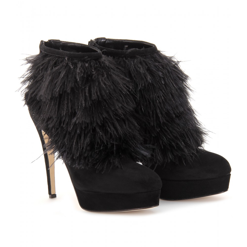 aa0fc1316563 Black suede ankle boots with black ostrich feathered detail around the  front and top. Black zipper down the back with a suede pull tab. Rounded  cap.