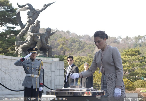 Crown Princess Victoria of Sweden burns incense at Seoul National Cemetery during her visit to South Korea