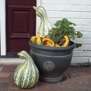 Fall Front Porch Decorated with Gourds