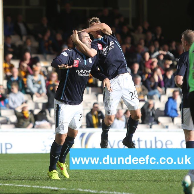 Dundee player Gary Harkins celebrates goal with WWE's famous RKO move
